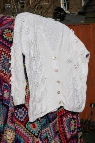 Cotton cardi in Aran design with balls